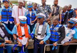 Lagos State Deputy Governor, Dr. Obafemi Hamzat (left); Governor Babajide Sanwo-Olu (second left); Managing Director/CEO, Lagos Ferry Services (Lagferry), Hon. Abdoulbaq Balogun (right) during the launch of Lagferry Operations, Mobile App and new Boats at Badore Ferry Terminal, Ajah, on Tuesday, February 4, 2020. With them behind (L-R): Commissioner for Tourism, Arts and Culture, Pharm. (Mrs) Uzamat Akinbile-Yusuf; Opeluwa of Lagos, Chief Lateef Ajose and the Secretary to the State Government, Mrs. Folashade Jaji.